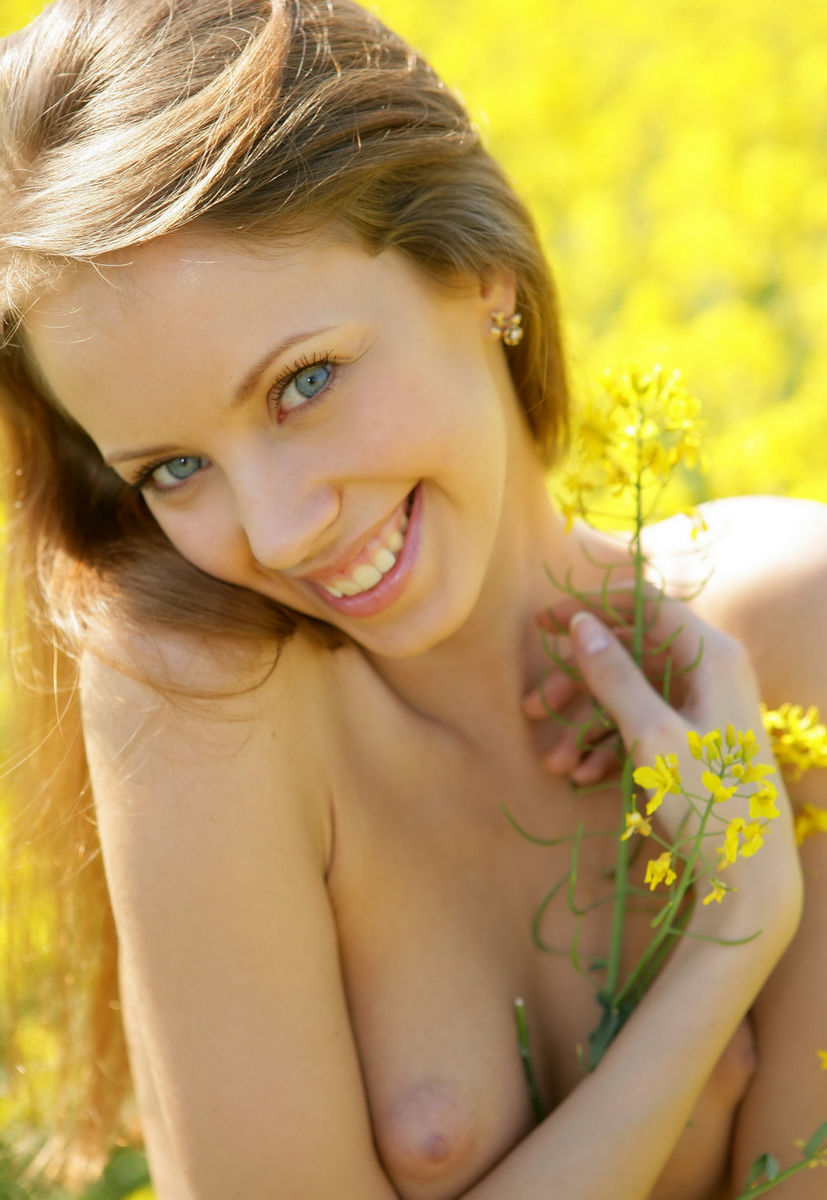 Beautiful Girl Nude In Field With Yellow Flowers